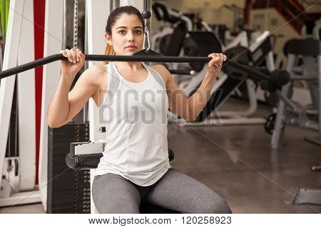 Cute Girl Exercising Her Back At The Gym