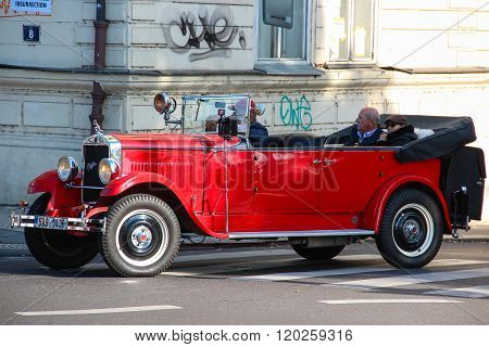 Red Praga car used for sightseeing tours in the streets of Prague.