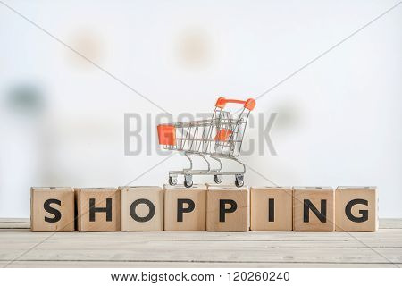 Shopping Cart On A Wooden Sign