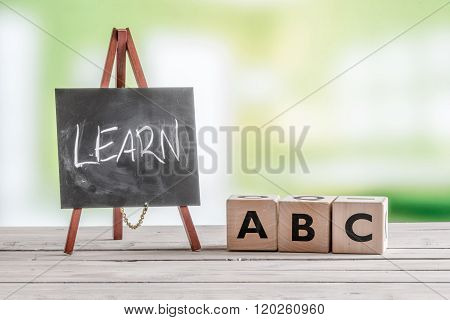 Blackboard And Cubes With Alphabet