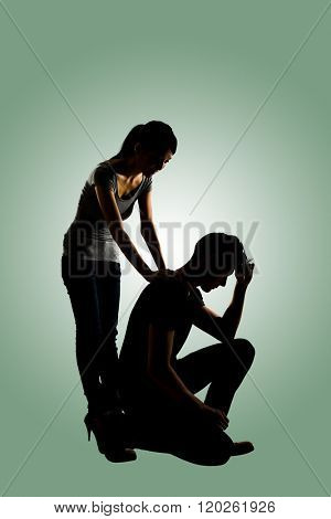 Silhouette of one sad Asian man squat and his wife give comfort to him, full length portrait isolated