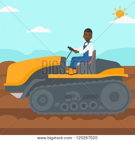 Farmer driving catepillar tractor.