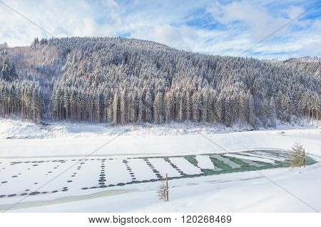 winter landscape with forest abd frozen lake
