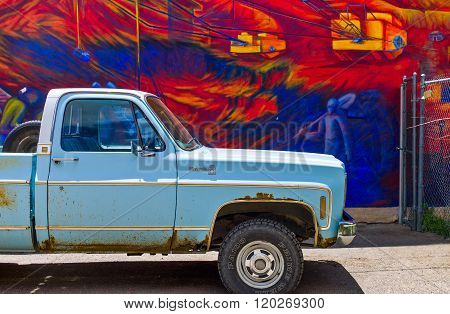 Gallup, U.S.A. - May 23, 2011: New Mexico, an old car in front of mural paintings along the Route 66.