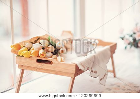 Beautifully Decorated Tray With A Bouquet Of Tulips And A Cup Of Tea