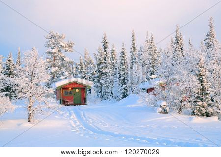 Sunrise Winter landscape with house at Kiruna Sweden lapland
