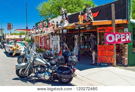 Seligman, U.S.A. - May 25, 2011: Arizona, motorcycles in front of a vintage store on the Route 66.
