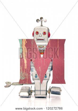 robot holding M