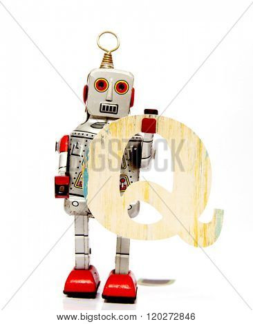retro robot with the letter  Q