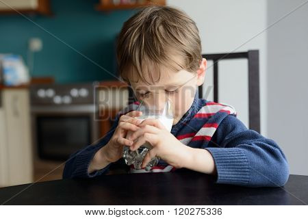Preschooler Politely Drinking The Milk At The Table