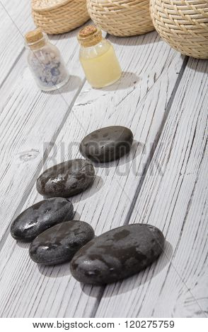 stones for oriental spa massage therapy on wood background ** Note: Shallow depth of field