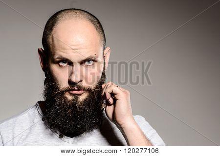 Closeup Of Bearded Man Touching His Beard
