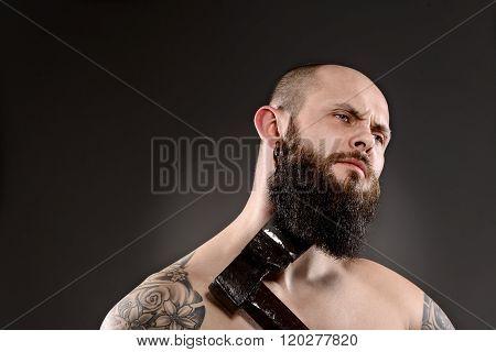 Topless Bearded Man Grooming His Beard