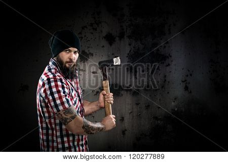 Serious Bearded Lumberjack Holding An Axe
