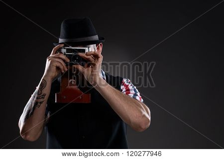 Hipster In Checkered Shirt Taking The Picture