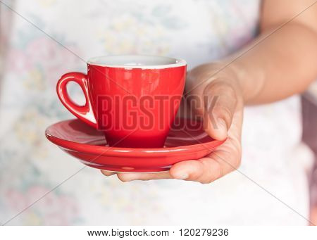 Woman's Hand Holding Red Coffee Cup