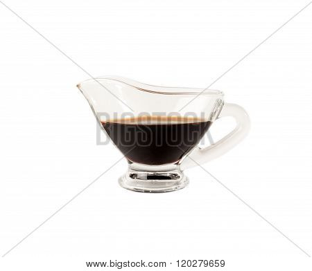 Soy sauce in saucers of glass isolated on white background.