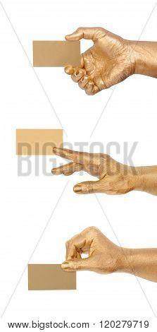 Man's golden hand holding an empty business card