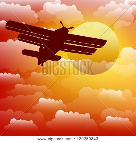 Biplane on the background of the sunset. Vector.