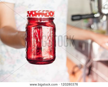 Woman's Hand Holding Red Glass