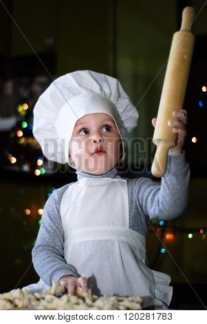 Little Cook With A Raised Rolling Pin