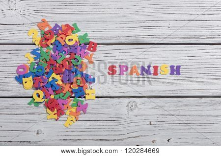 many colorful words on white wooden background, spanish