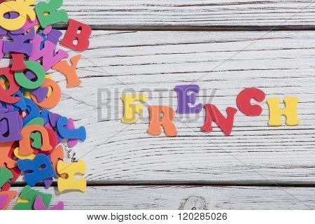 many colorful words on white wooden background, french