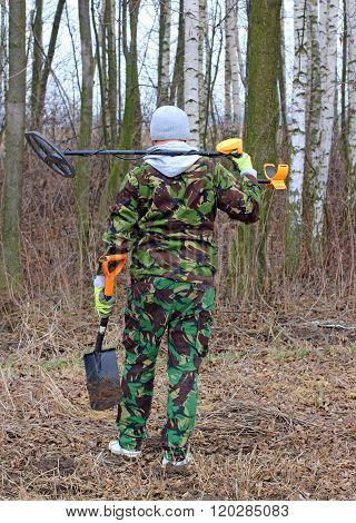 Treasure hunter - man with metal detector