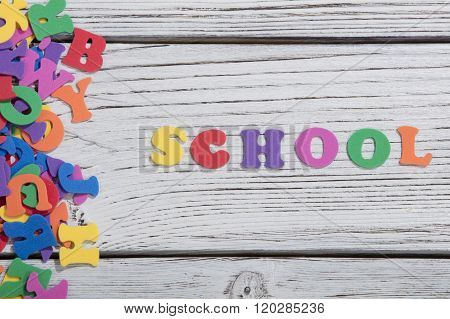 many colorful words on white wooden background, school