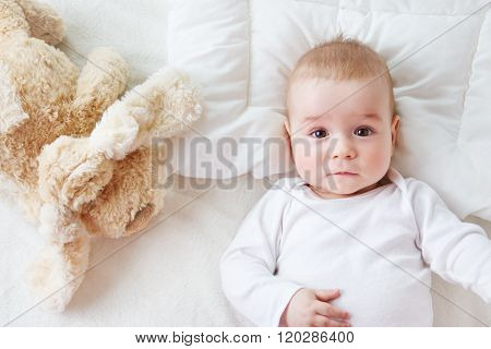 seven month old baby in the bed