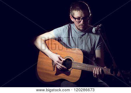 Man Singer In Plays Guitar And Sings.
