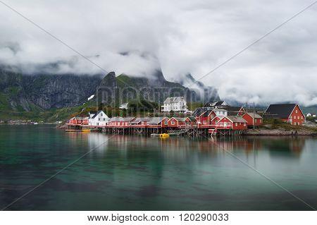 Norway village Reine near the mountains after rain