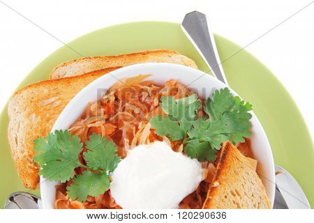 red vegetable soup in white bowl on green