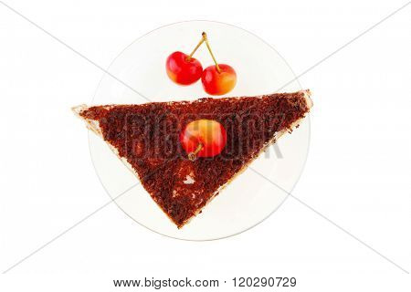 cheesecake with cherry on transparent saucer on white