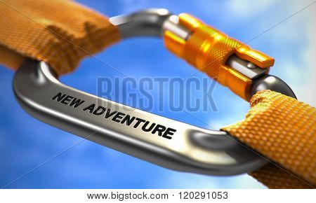New Adventure on Chrome Carabiner between Orange Ropes.
