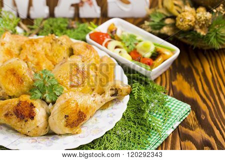 Christmas Roast Chicken with Red Hot Peppers, Olives, Onion, Parsley on Brown Wood Table with Christ
