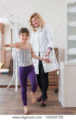 Physical Therapist Doing Medical Exam With Little Boy