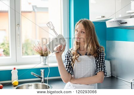 Woman Holding Hand Mixer