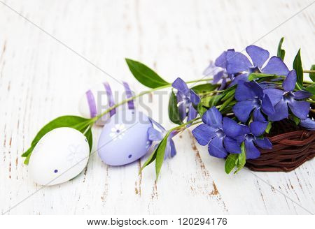 Basket With  Periwinkle And Easter Eggs