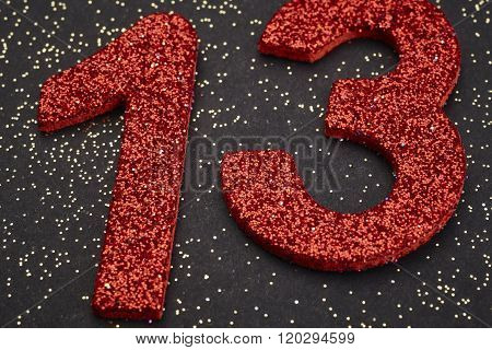 Number Thirteen Red Color Over A Black Background. Anniversary