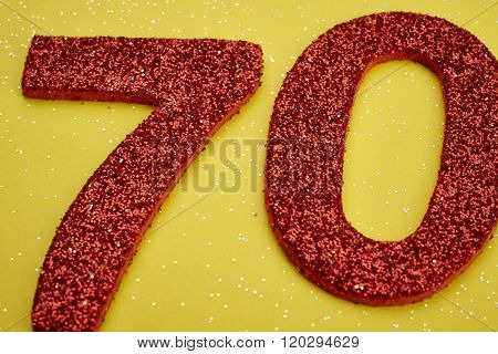 Number Seventy Red Color Over A Yellow Background. Anniversary