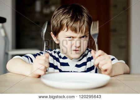 Furious Little Boy Waiting For Dinner