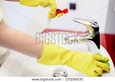 Female Hands  Spraying Liquid Detergent On Tap