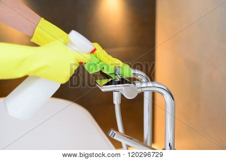 Hands With Yellow Rubber Protective Gloves Cleaning Bath Mixer