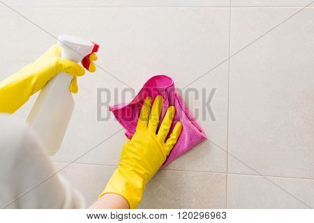 Cleaning Tiles In Bathroom With Pink Cloth