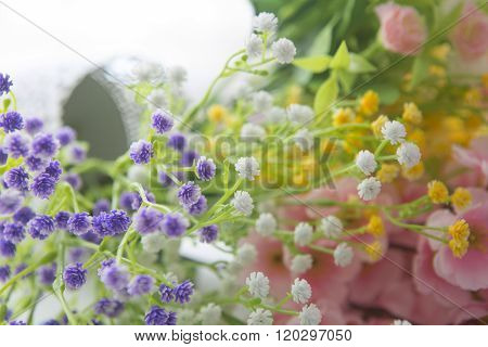 Wildflowers On The Background Of Wood