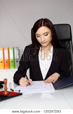 Brunette Woman Notary Public Notarizes The Contract