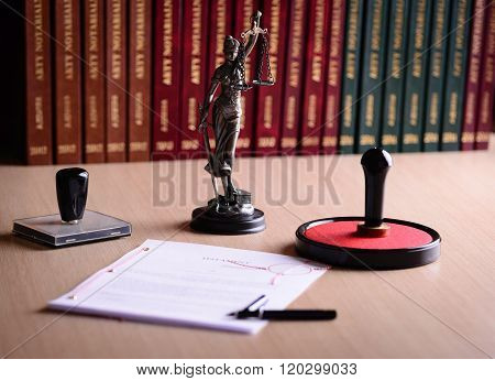 Document Waiting For A Notary Public Sign On Desk
