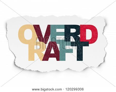 Finance concept: Overdraft on Torn Paper background