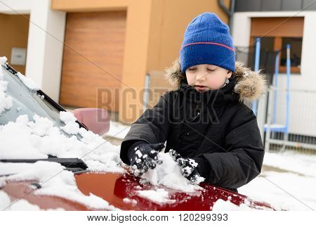 Boy Playing With Snow Outside